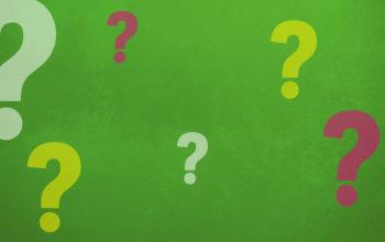 Fragezeichen auf Grünem Grund